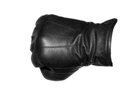 A clenched fist in a leather glove on a white background. Banco de Imagens