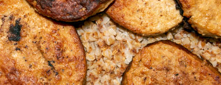 Meat cutlets with buckwheat photo.Buckwheat porridge with cutlets background top view.