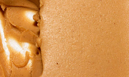 Light brown peanut paste made from whole nuts.Peanut paste background top view.Peanut paste texture top view.Peanut butter cream for spreading. 版權商用圖片