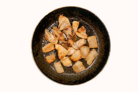 Fried pork fat background top view. Homemade pork rinds made from lard. 版權商用圖片