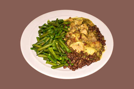 Beans with meat dish top view. Meat with string beans background.