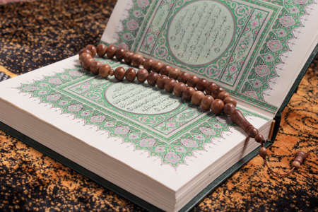 islamic pray: The holy Quran and tasbih Stock Photo