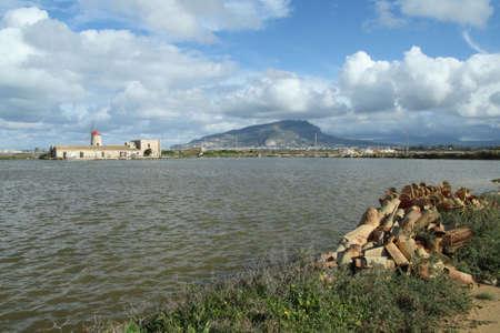 Mont Erice and salt flats photo