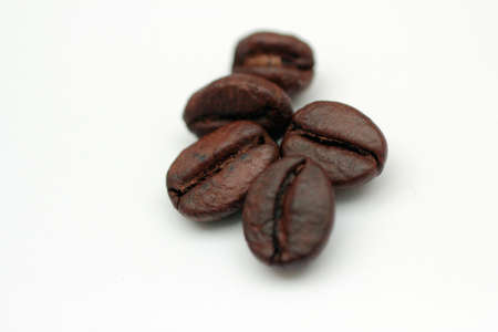 coffee bar: Five coffee beans on white background