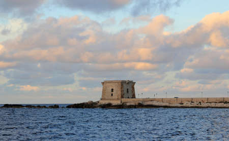 trapani: Sunset on the Ligny Tower - Trapani Stock Photo