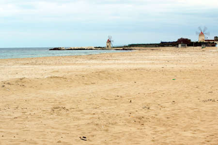 The beach and the mills of Trapani - Sicily photo