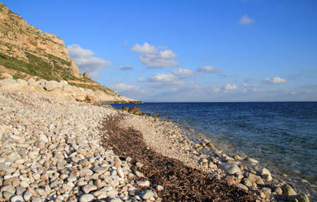 levanzo: Small pebble beach with crystal clear sea - Egadi islands Stock Photo