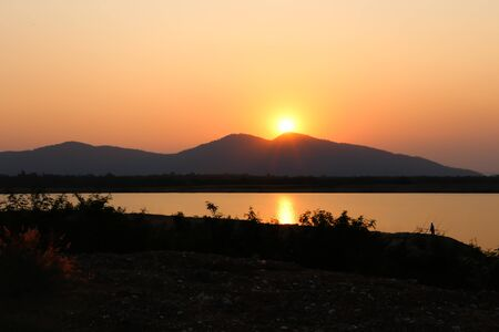 Sunset on the mountain at Huay Mai Teng water reservoir in Ratchaburi, Thailand