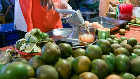 Local seller make orange juice at floating market, Bangkok, Thailand Stock Photo