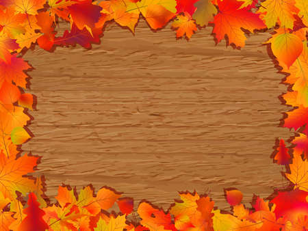 Autumn background with colored leaves on wooden board.  photo