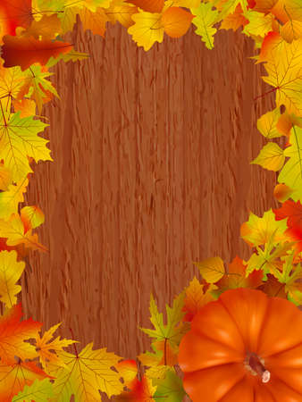 Fall leaves and pumpkins on wood background.  photo