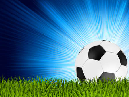 football pitch: Football or soccer ball on grass with a star burst background.