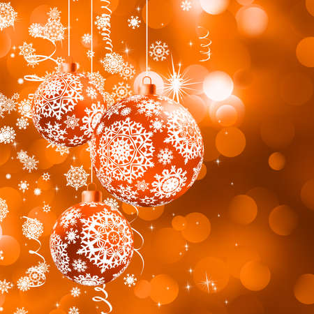 Christmas balls over orange bokeh background.