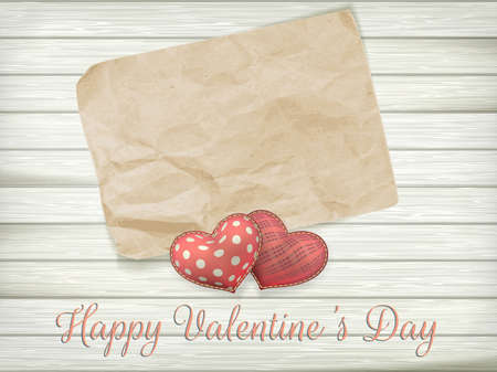soft toy: Blank old piece of paper and vintage handmaded valentines day toy hearts over wooden background. EPS 10 vector file included