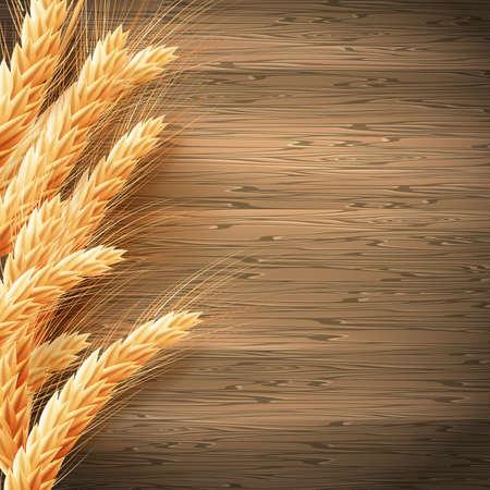 木材の背景の小麦。