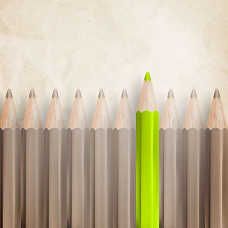 sharpened: Pencils with tips facing upwards against parchment textured paper.