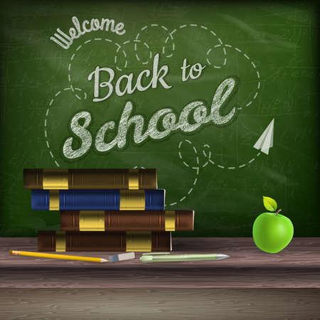 convivencia escolar: Libros escolares y manzana contra la pizarra.