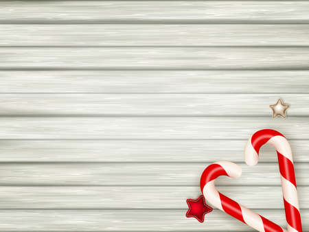 candy canes: Christmas candy canes on weathered wooden board.