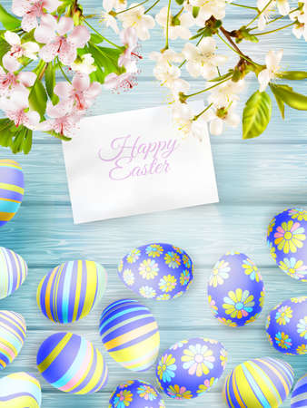 wooden board: Flowers and easter eggs on the wooden background.