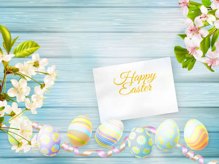 easter background: Easter eggs, greeting card and cherries blossom on a old wooden background.