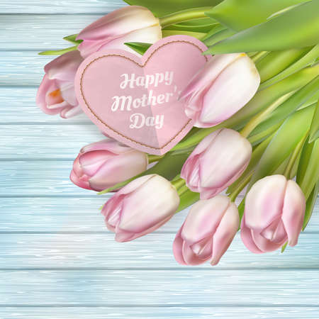 mother's day: Beautiful bouquet of pink tulips and card on blue wooden background.