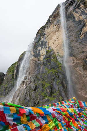 upland: YUBENG, CHINA - Aug 10 2014: Holy Waterfall at Yubeng Village. a famous landscape in the Tibetan village of Deqin, Yunnan, China.
