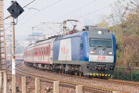 HENAN, CHINA - NOV 19 2014: China Railways HXD3 electric locomotive in Luoyang, Henan, China. The locomotive is designed for hauling 5000t freight trains.