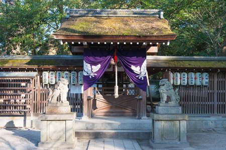 city and county building: KYOTO, JAPAN - Jan 11 2015: Munakata Shrine of Kyoto Gyoen Garden. a famous historical site in the Ancient city of Kyoto, Japan.
