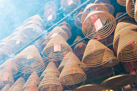 mococa: Hong Kong - Dec 04 2015: Circular incenses at Man Mo Temple. a famous historic site in Tai Po, Hong Kong. Stock Photo