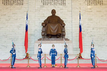 TAIPEI, TAIWAN - Jan 30 2016: Soldiers stand guard at Chiang Kai-shek Memorial Hall. a famous historic site in Taipei, Taiwan.