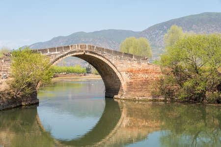 river county: YUNNAN, CHINA - MAR 20 2015: Yujin Bridge at Shaxi Ancient village. a famous Ancient village of Jianchuan, Yunnan, China.