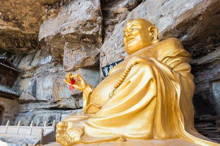 YUNNAN, CHINA - MAR 21 2015: Baoxiang temple at Shibaoshan Mountain(Shibaoshan Shiku). a famous historical site of Jianchuan, Yunnan, China.