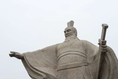 HENAN, CHINA - Oct 28 2015: Statue of Cao Cao(155-220) at Weiwudi Square. a famous historic site in Xuchang, Henan, China.
