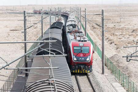 famous industries: GANSU, CHINA - Apr 13 2015: China Railways HXD1D electric locomotive in Jiayuguan, Gansu, China. HXD1D used on the China Railway network. Editorial