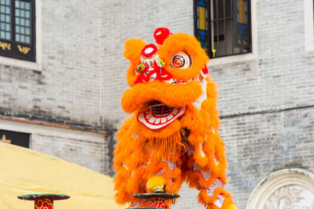 GUNAGDONG, CHINA - Nov 28 2015: Lion Dance at Foshan Ancestral Temple(Zumiao Temple). a famous historic site in Foshan, Guangdong, China. Editorial