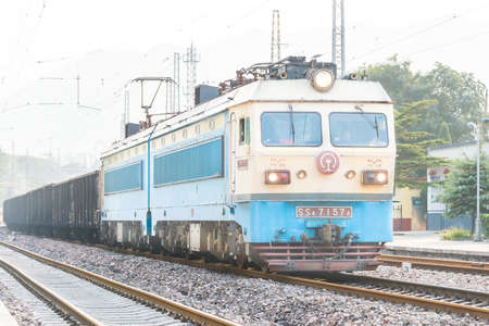 famous industries: SHANXI, CHINA - Sept 15 2015: China Railways SS4 electric locomotive in Niangziguan Railway Station, Shanxi, China. SS4 used on the China Railway network.