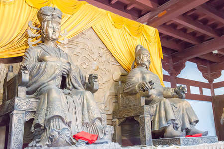 empress: SICHUAN, CHINA - Mar 29 2015: Statues of Empress Wu Zetian and Emperor Gaozong at Huangze Temple. a famous historic site in Guangyuan, Sichuan, China.
