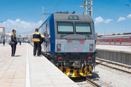 famous industries: XINJIANG, CHINA - May 29 2015: China Railways HXD3C electric locomotive in Korla Railway Station, Xinjiang, China. HXD3C used on the China Railway network.