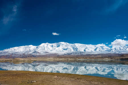 xinjiang: XINJIANG, CHINA - May 21 2015: Karakul Lake. a famous landscape on the Karakoram Highway in Pamir Mountains, Akto County,Kizilsu Kirghiz Autonomous Prefecture, Xinjiang, China.