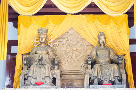 SICHUAN, CHINA - Mar 29 2015: Statues of Wu Zetian and Emperor Gaozong at Huangze Temple. a famous historic site in Guangyuan, Sichuan, China. Editorial