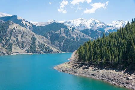 xinjiang: XINJIANG, CHINA - May 09 2015: Heaven Lake of Tian Shan(Tianchi). a famous World Heritage site in Fukang, Changji, Xinjiang, China.