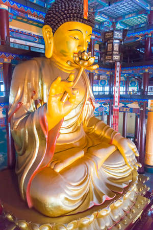 tourist site: LIAONING, CHINA - Aug 03 2015: Budda statue at Guangyou Temple Scenic Area.A famous historic site in Liaoyang, Liaoning, China.