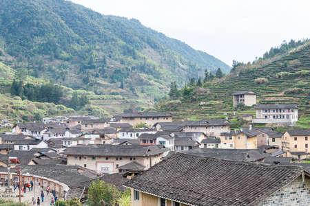 scenic spots: FUJIAN, CHINA - Jan 02 2016: Taxia Village at Tianloukeng Tulou Scenic Spots in Fujian Tulou(Nanjing) Scenic Area(UNESCO World Heritage)