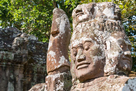 Siem Reap, Cambodia - Dec 10 2016: Closeup of statue at Victory Gate in Angkor Thom. a famous Historical site in Angkor, Siem Reap, Cambodia.