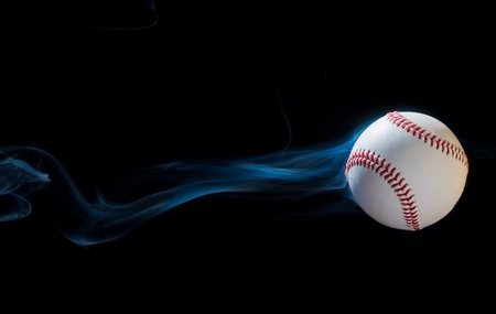 throw up: Baseball illusion flying through the black sky. Stock Photo