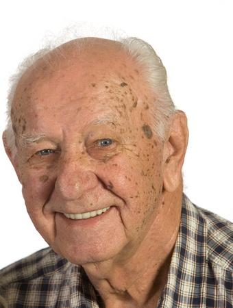 Closeup of senior man. Shot against a white background.