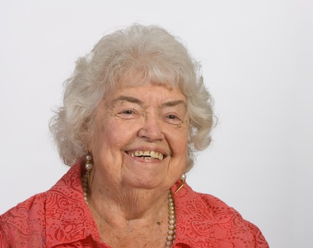 Portrait of a cheerful and happy senior woman photo