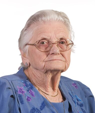Portrait of old senior woman with glasses. Shot against white background. Фото со стока