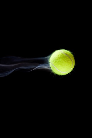 balls kids: Fast moving tennis ball simulated with smoke. Stock Photo