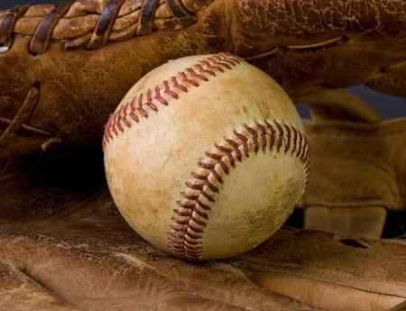 Closeup of worn baseball and old ragged glove Foto de archivo